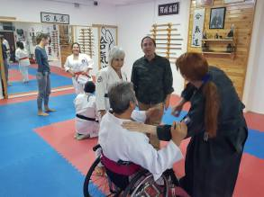 Roisin instructing wheelchair user Osi Ertos